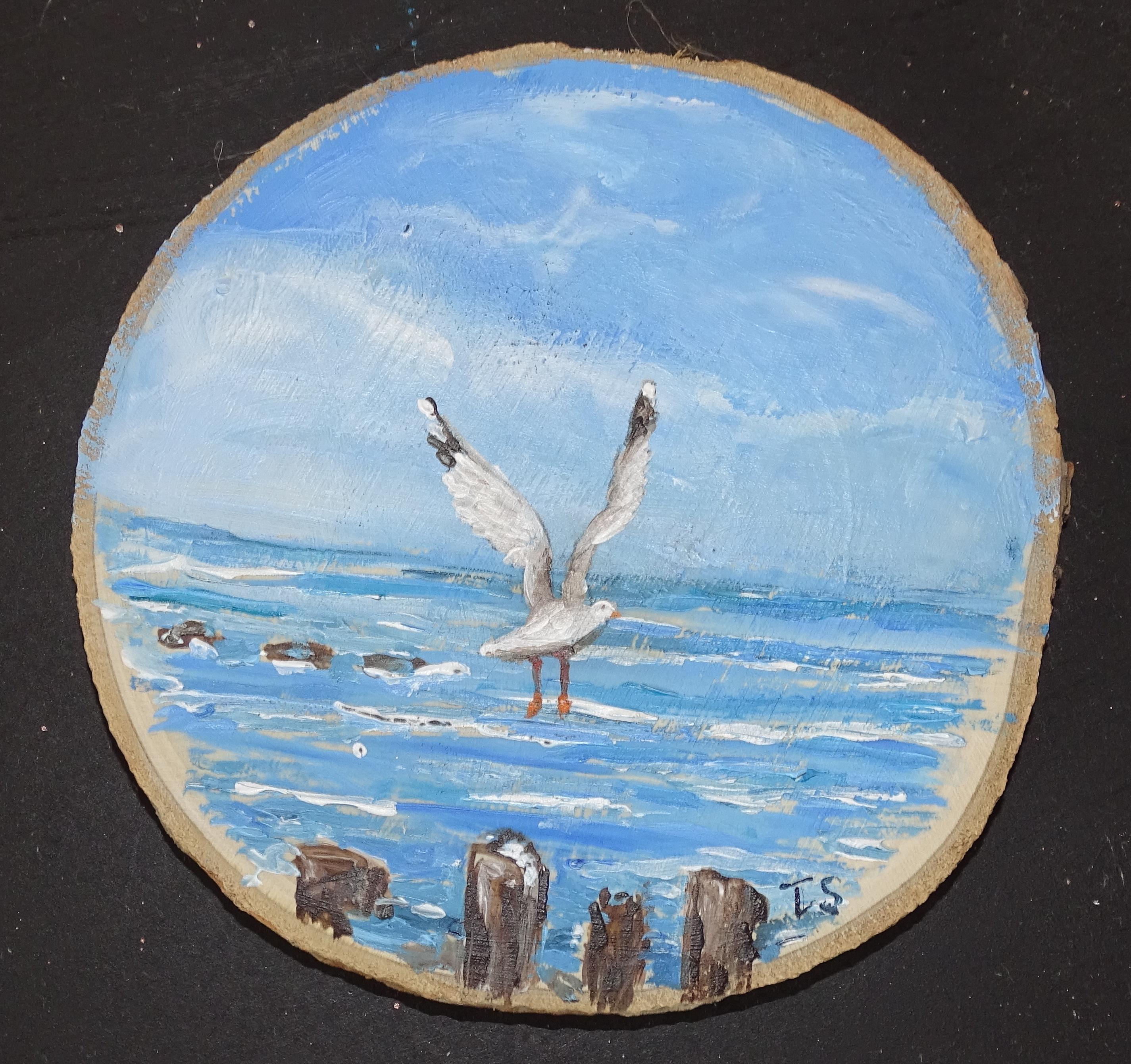 Meeuw en zee op houtschijf 12x12  7,50