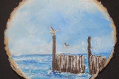 Palen in zee op houtschijf 12x12  7,50